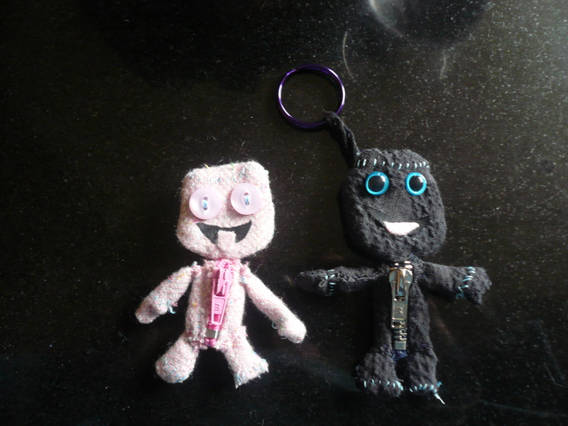 Sackgirl and Sackboy from Little Big Planet as a brooch and keyring respectively