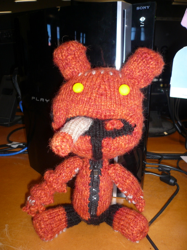 A knitted Hellboy Sackboy from Little Big Planet